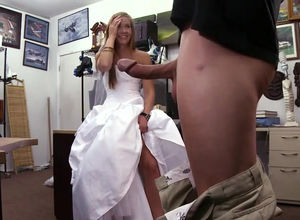Teenage bride in a wedding dress. This..